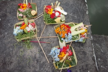 colourful flowers decorate a Bali shrine