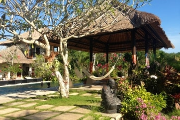 Bali hotel courtyard with hammock and pool