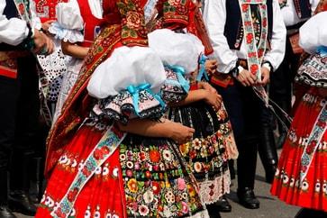 Eastern European performers wearing traditional garb