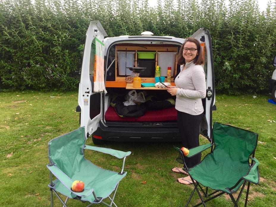 enjoying breakfast from her Iceland camper van