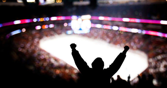 fan cheering at hockey game