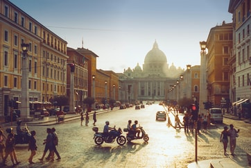 sun rising over St Peter's Basilica in Rome