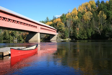 red covered bridge in Quebec